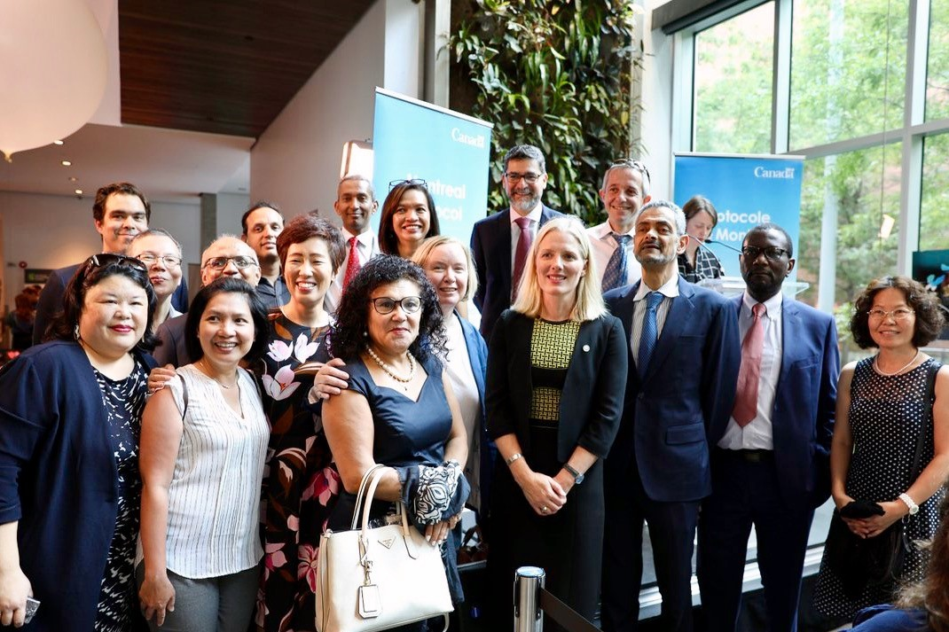 Staff of the Fund Secretariat celebrate the 30th anniversary of the Montreal Protocol with the Hon. Catherine McKenna, Minister of Environment and Climate Change